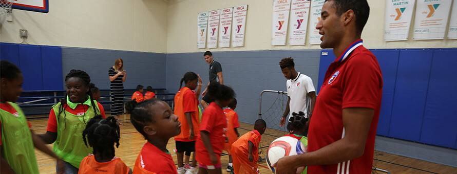 Major League Soccer players teaching kids about soccer